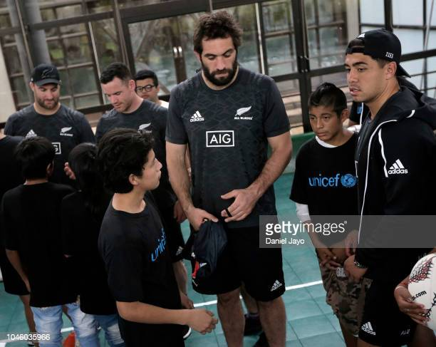 Anton Lienert Brown and Sam Whitelock of New Zealand All Blacks greet children at the end of a a sports clinic with a teenage rugby team of the...