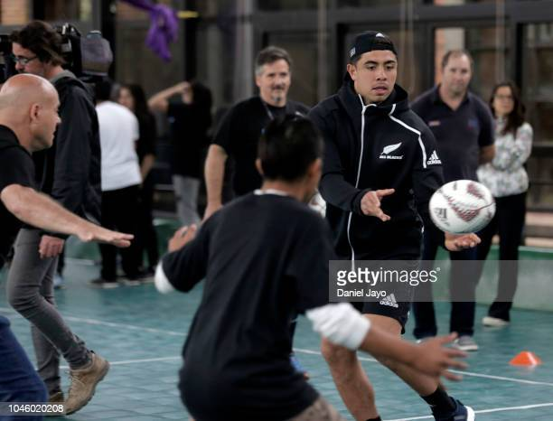 Anton Lienert Brown of New Zealand All Blacks passes the ball during a sports clinic with a teenage rugby team of the indigenous Qom community from...