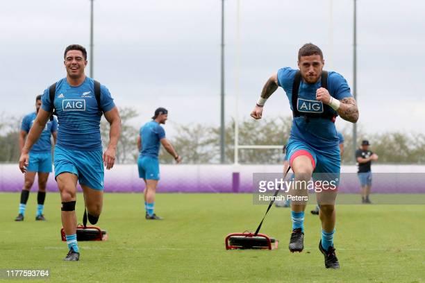 Anton LienertBrown and TJ Perenara of the All Blacks run through drills during a New Zealand training session at Jissoji Tamokuteki Ground on...