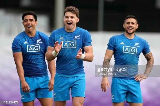 Anton LienertBrown Beauden Barrett and TJ Perenara of the All Blacks react during a New Zealand All Blacks training session at Tatsuminomori Seaside...