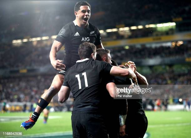 Anton Lienert-Brown celebrates a try to Sevu Reece of the All Blacks during The Rugby Championship and Bledisloe Cup Test match between the New...