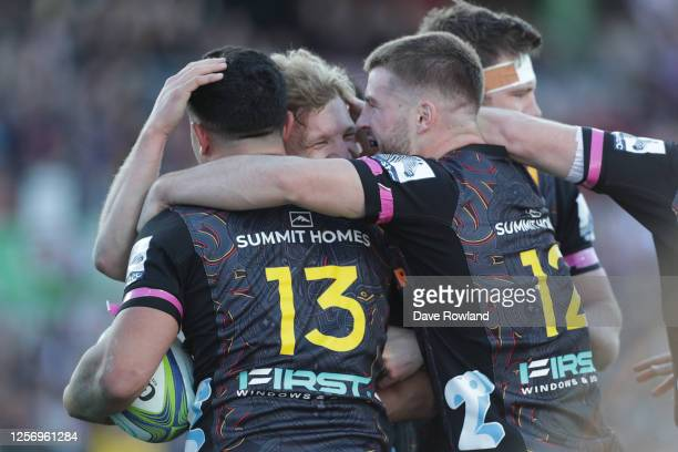 Anton Lienert-Brown is congratulated on scoring by Damian McKenzie and Alex Nankivell of the Chiefs during the round 6 Super Rugby Aotearoa match...