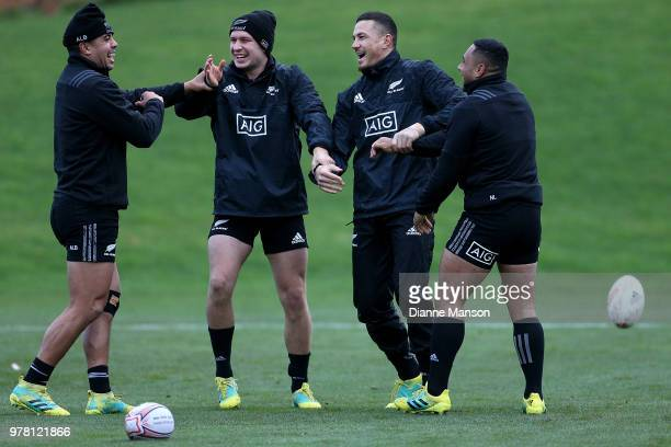 Anton LienertBrown Jack Goodhue Sonny Bill Williams and Ngani Laumape of the All Blacks warm up during a New Zealand All Blacks training session on...