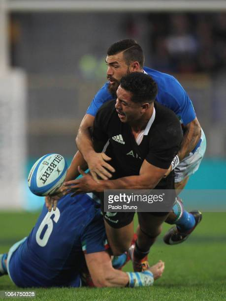 Anton LienertBrown of New Zealand is tackled by Jayden Hayward of Italy during the international friendly match between Italy and New Zealand at...