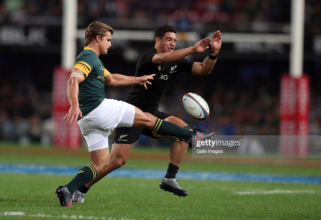 Anton Lienert-Brown of New Zealand looks to charge down Patrick Lambie of South Africa during the The Rugby Championship match between South Africa and New Zealand at Growthpoint Kings Park on October 08, 2016 in Durban, South Africa.