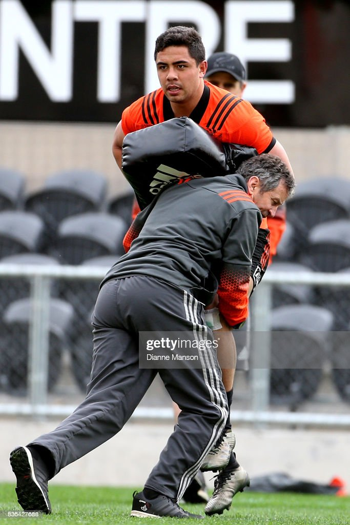 Anton Lienert-Brown of the All Blacks is tackle by Wayne Smith, assistant coach, during a New Zealand All Blacks Training Session on August 22, 2017 in Dunedin, New Zealand.