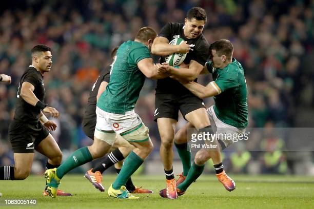 Anton LienertBrown of the All Blacks is tackled during the International Friendly match between the New Zealand All Blacks and Ireland on November 17...