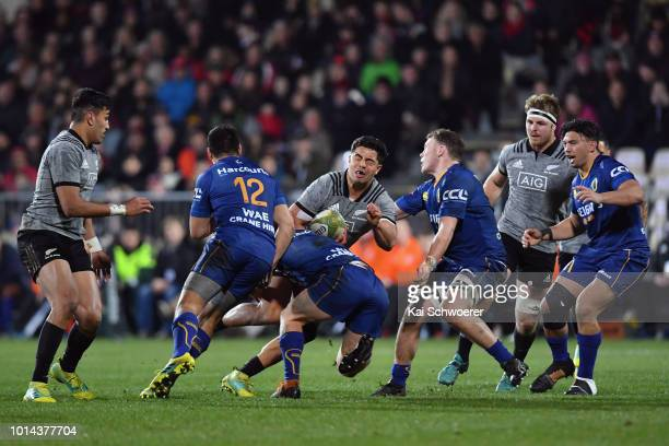 Anton LienertBrown of the All Blacks is tackled during the Game of Three Halves between the New Zealand All Blacks and Otago at AMI Stadium on August...
