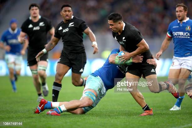 Anton LienertBrown of the All Blacks is tackled during the International Rugby match between the New Zealand All Blacks and Italy at Stadio Olimpico...