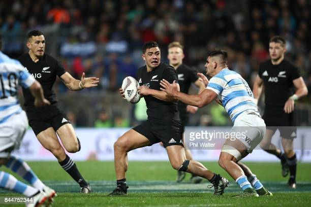 Anton LienertBrown of the All Blacks is tackled during The Rugby Championship match between the New Zealand All Blacks and Argentina at Yarrow...