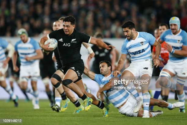 Anton LienertBrown of the All Blacks makes a break against Martin Landajo of Argentina during The Rugby Championship match between the New Zealand...