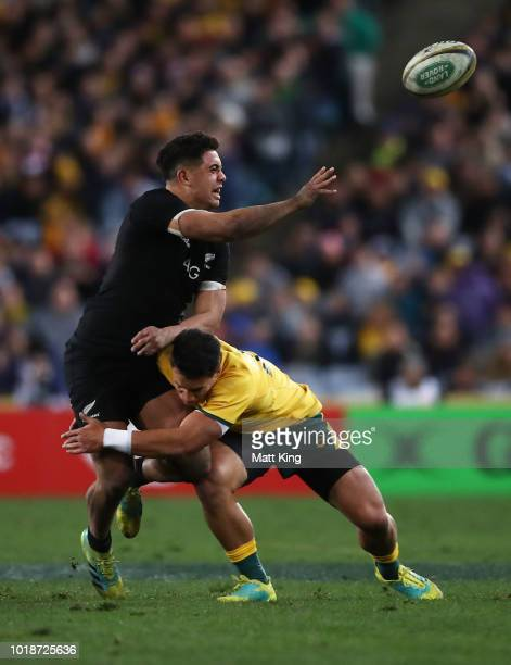 Anton LienertBrown of the All Blacks offloads the ball in a tackle during The Rugby Championship Bledisloe Cup match between the Australian Wallabies...