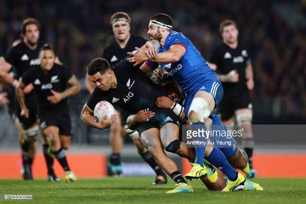 Anton LienertBrown of the All Blacks on the charge against Geoffrey Doumayrou of France during the International Test match between the New Zealand...
