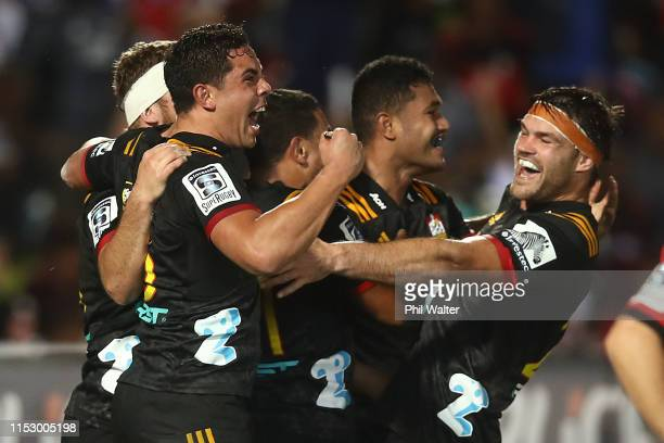 Anton LienertBrown of the Chiefs celebrates a try to Tumua Manu during the round 16 Super Rugby match between the Chiefs and the Crusaders at the ANZ...