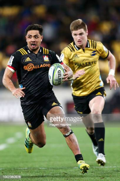 Anton LienertBrown of the Chiefs is chased down by Jordie Barrett of the Hurricanes during the Super Rugby Qualifying Final match between the...