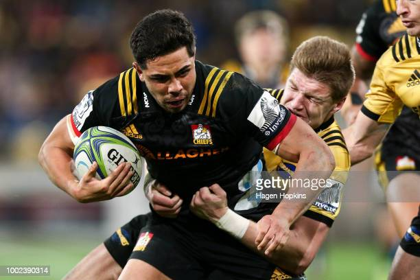 Anton LienertBrown of the Chiefs is tackled by Jordie Barrett of the Hurricanes during the Super Rugby Qualifying Final match between the Hurricanes...