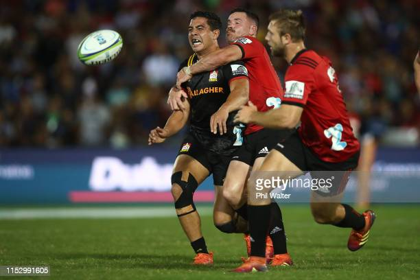 Anton LienertBrown of the Chiefs is tackled during the round 16 Super Rugby match between the Chiefs and the Crusaders at the ANZ National Stadium on...