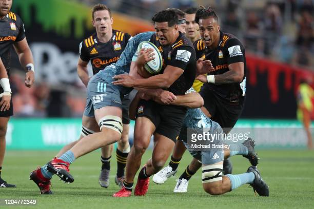 Anton Lienert-Brown of the Chiefs is tackled during the round 2 Super Rugby match between the Chiefs and the Crusaders at FMG Stadium on February 08,...