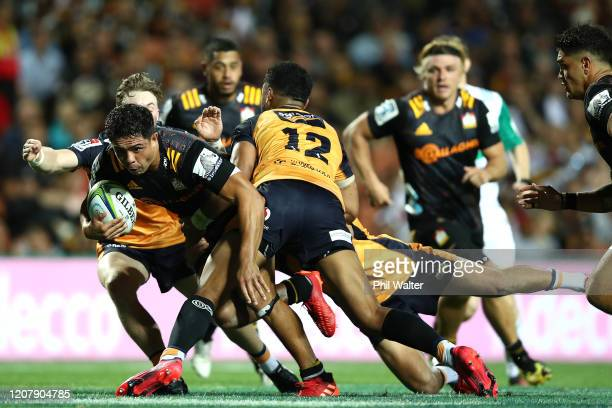 Anton Lienert-Brown of the Chiefs is tackled during the round four Super Rugby match between the Chiefs and the Brumbies at FMG Stadium on February...