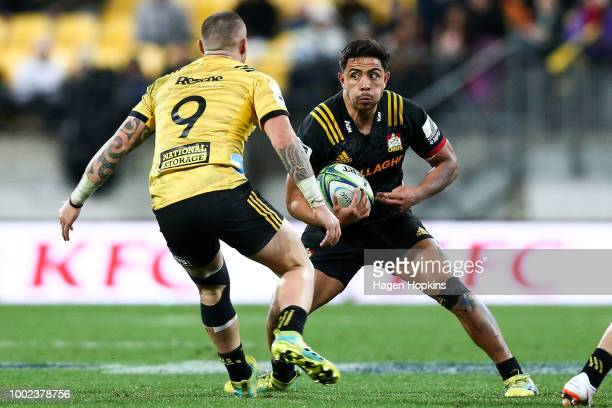 Anton LienertBrown of the Chiefs looks to evade TJ Perenara of the Hurricanes during the Super Rugby Qualifying Final match between the Hurricanes...