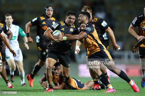 Anton Lienert-Brown of the Chiefs makes a break during the round four Super Rugby match between the Chiefs and the Brumbies at FMG Stadium on...