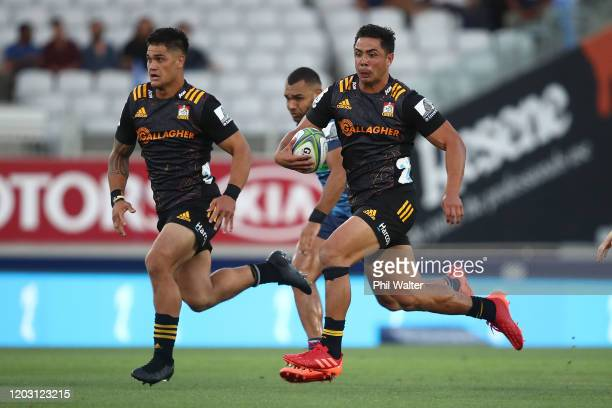 Anton LienertBrown of the Chiefs makes a break during the round one Super Rugby match between the Blues and the Chiefs at Eden Park on January 31...
