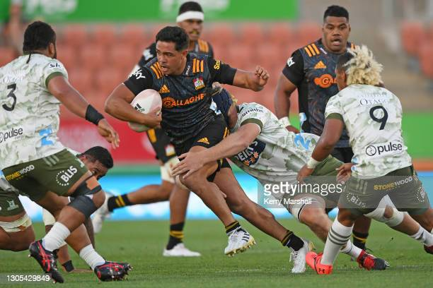 Anton Lienert-Brown of the Chiefs makes a break during the round two Super Rugby Aotearoa match between the Chiefs and the Highlanders at FMG Stadium...