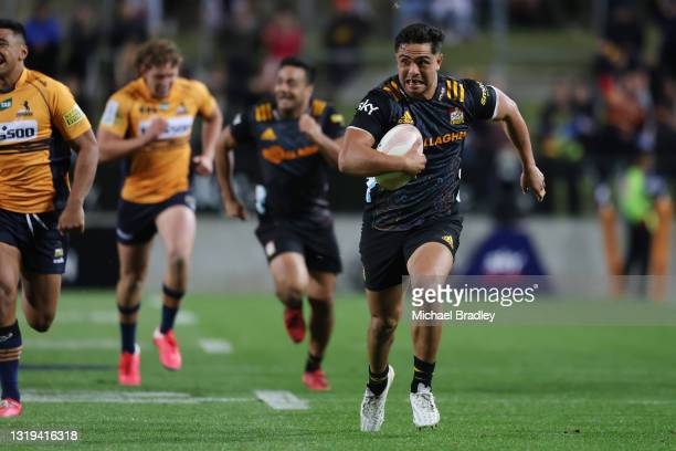 Anton Lienert-Brown of the Chiefs makes a run to score a try during the round two Super Rugby Trans-Tasman match between the Chiefs and the ACT...