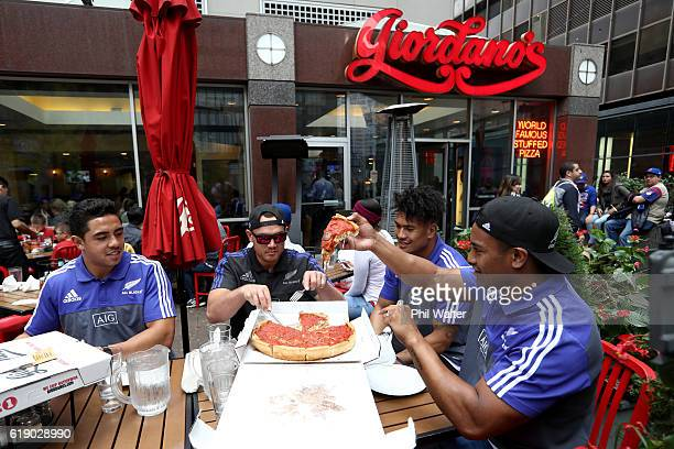 Anton LienertBrownIsrael Dagg Ardie Savea and Julian Savea of the New Zealand All Blacks eat a deep dish pizza on October 29 2016 in Chicago Illinois...