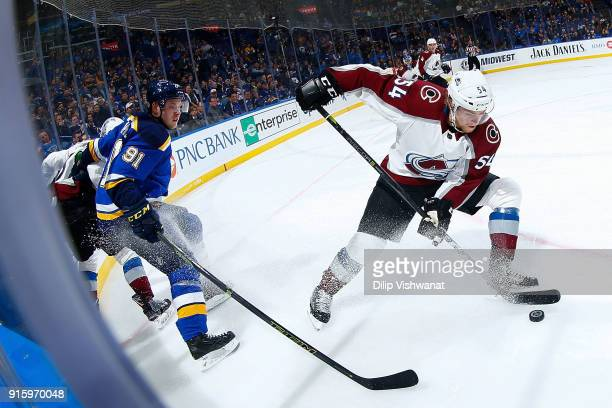 Anton Lindholm of the Colorado Avalanche beats Vladimir Tarasenko of the St Louis Blues to the puck at Scottrade Center on February 8 2018 in St...