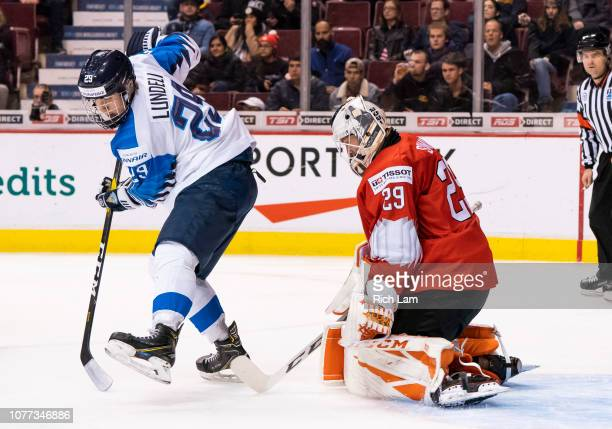 Anton Lundell of Finland redirects the shot wide on goalie Akira Schmid of Switzerland in Semifinals hockey action of the 2019 IIHF World Junior...