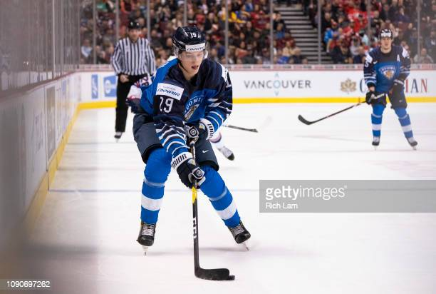 Anton Lundell of Finland skates with the puck in Gold Medal hockey action of the 2019 IIHF World Junior Championship against the United States on...