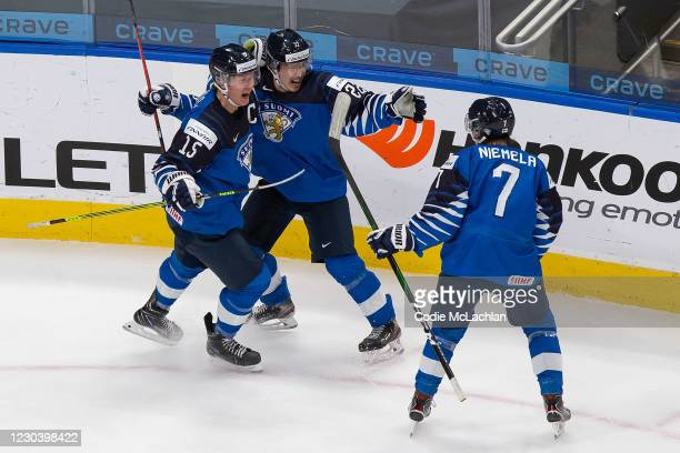 Anton Lundell, Roni Hirvonen and Topi Niemela of Finland celebrate a goal against during the 2021 IIHF World Junior Championship quarterfinals at...