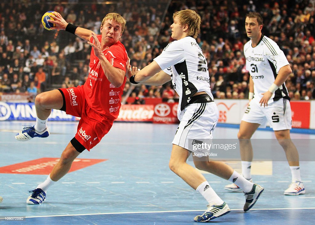 Anton Mansson (R) of Melsungen is challenged by Aron Palmarsson of Kiel during the Toyota Handball Bundesliga match between THW Kiel and MT Melsungen at the Sparkassen Arena on February 23, 2011 in Kiel, Germany.