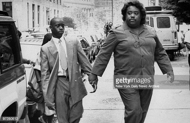 Anton McCray accused of raping and beating a Central Park jogger walks to court with the Rev Al Sharpton