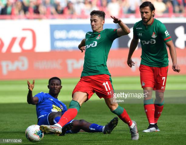 Anton Miranchuk and Grzegorz Krychowiak of FC Lokomotiv Moscow and Usman Muhammed of FC Tambov vie for the ball during the Russian Football League...