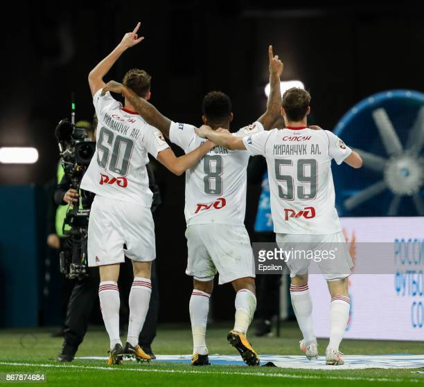 Anton Miranchuk Jefferson Farfan and Aleksei Miranchuk of FC Lokomotiv Moscow celebrate a goal during the Russian Football League match between FC...