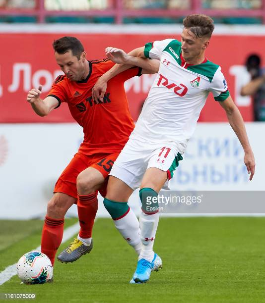 Anton Miranchuk of FC Lokomotiv Moscow and Denys Kulakov of FC Ural Yekaterinburg vie for the ball during the Russian Football League match between...