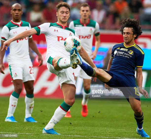 Anton Miranchuk of FC Lokomotiv Moscow and Khoren Bayramyan of FC Rostov Rostov on Don vie for the ball during the Russian Football League match...
