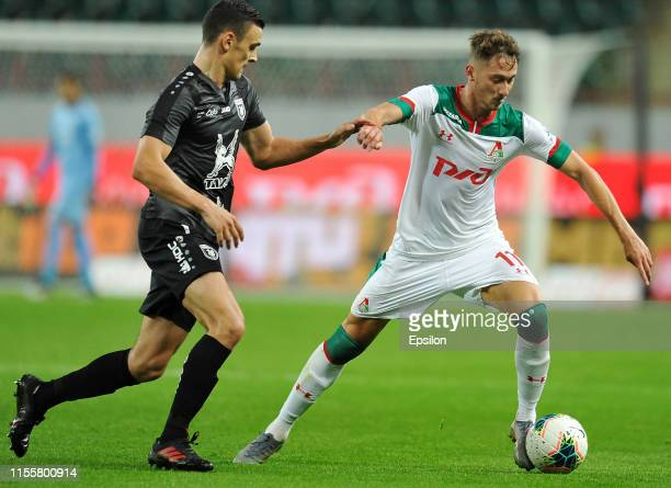 Anton Miranchuk of FC Lokomotiv Moscow and Philip Uremovic of FC Rubin Kazan vie for the ball during the Russian Premier League match between FC...