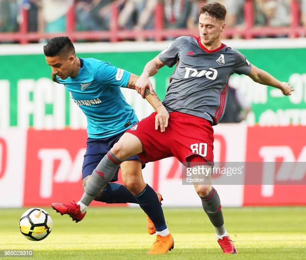 Anton Miranchuk of FC Lokomotiv Moscow vie for the ball with Sebastian Driussi of FC Zenit Saint Petersburg during the Russian Football League match...