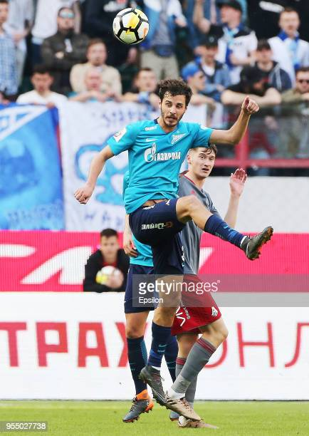 Anton Miranchuk of FC Lokomotiv Moscow vie for the ball with Aleksandr Yerokhin of FC Zenit Saint Petersburg during the Russian Football League match...
