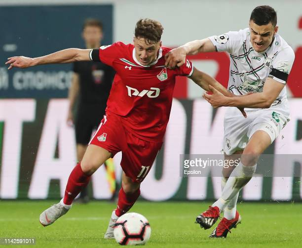 Anton Miranchuk of FC Lokomotiv Moscow vies for the ball with Filip Uremovic of FC Rubin Kazan during the Russian Premier League match between FC...