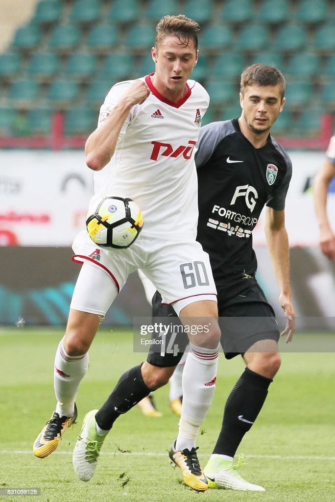 Anton Miranchuk of FC Lokomotiv Moscow vies for the ball with Alyaksandr Karnitsky of FC Tosno Khabarovsk during the Russian Premier League match between FC Lokomotiv Moscow and FC Tosno at Lokomotiv stadium on August 13, 2017 in Moscow, Russia.