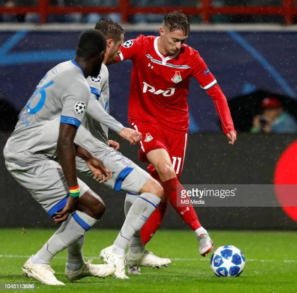 Anton Miranchuk of FC Lokomotiv Moscow vies for the ball with Salif Sane and Mark Uth of FC Schalke 04 during the Group D match of the UEFA Champions...