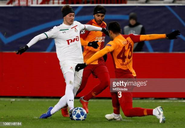 Anton Miranchuk of FC Lokomotiv Moscow vies for the ball with Selcuk Inan and Ozan Kabak of Galatasaray during the Group D match of the UEFA...