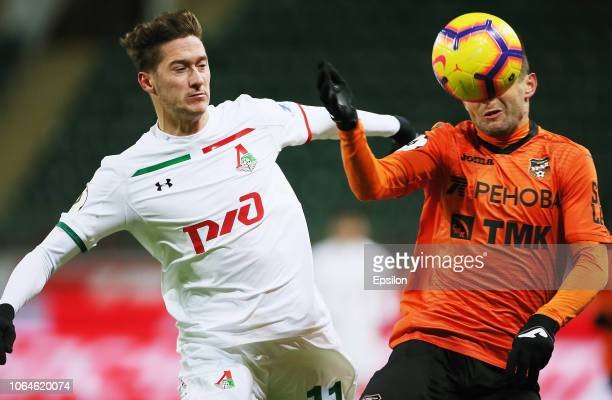 Anton Miranchuk of FC Lokomotiv Moscow vies for the ball with Yury Bavin of FC Ural Ekaterinburg during the Russian Premier League match between FC...