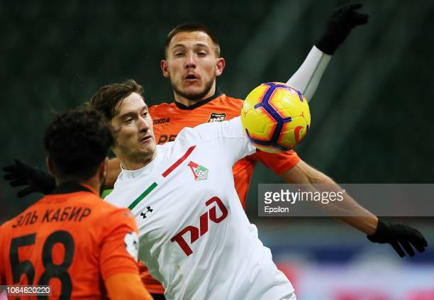 Anton Miranchuk of FC Lokomotiv Moscow vies for the ball withEl Kabir and Mikhail Merkulov of FC Ural Ekaterinburg during the Russian Premier League...
