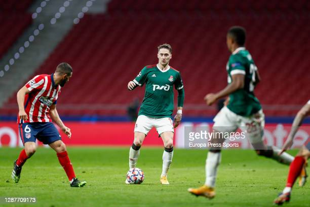 """Anton Miranchuk of Lokomotiv and Jorge Resurreccion """"Koke"""" of Atletico de Madrid in action during the UEFA Champions League Group A stage match..."""