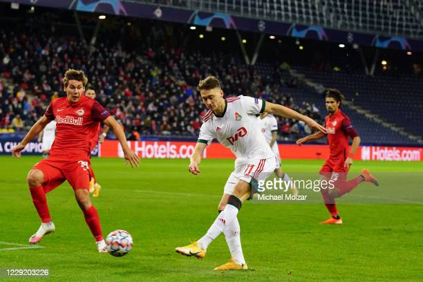 Anton Miranchuk of Lokomotiv Moscow shoots at the goal and Maximilian Woeber of Salzburg tries to block it during the UEFA Champions League Group A...